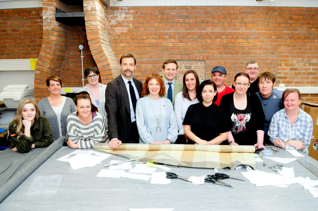 Patrick Grant and John Sugden pictured with staff and trainees of the LVMH Textile Training Centre