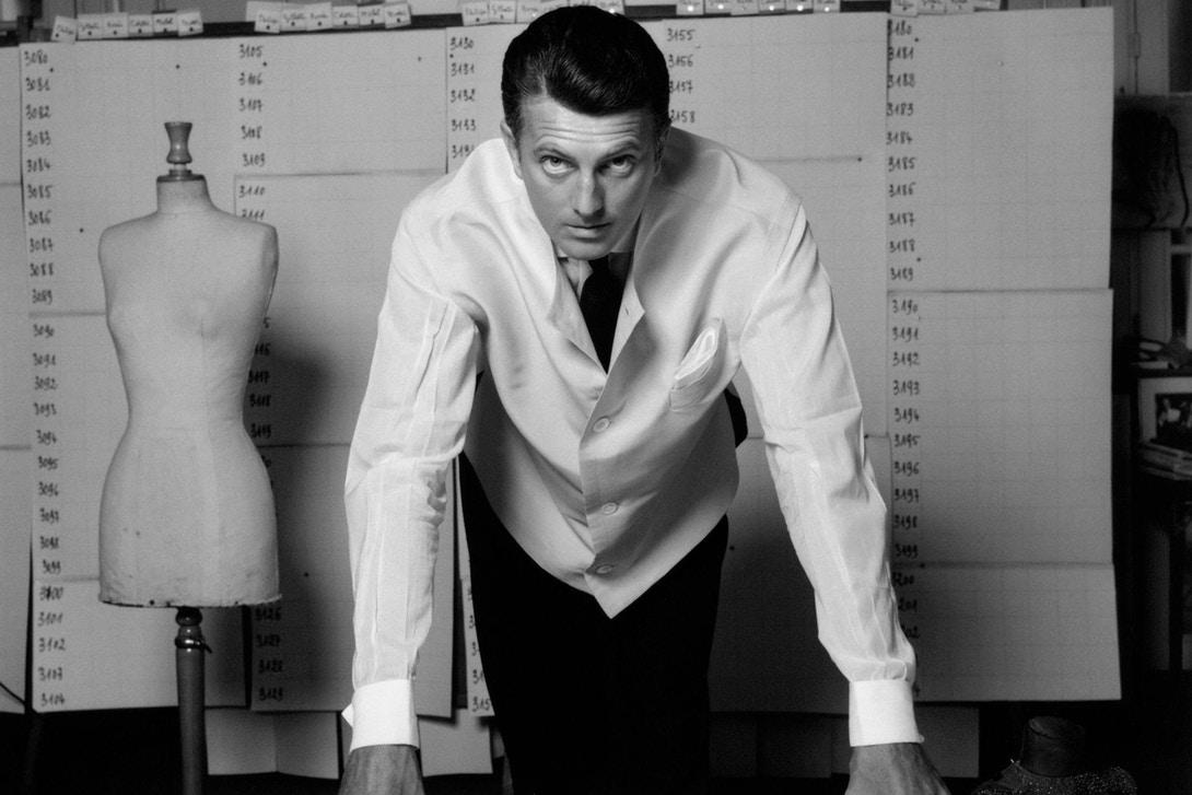 Givenchy in his white smock coat in his studio